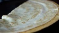 Chef preparing pancake and flip it video