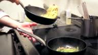 Chef preparing pasta on stew pan video