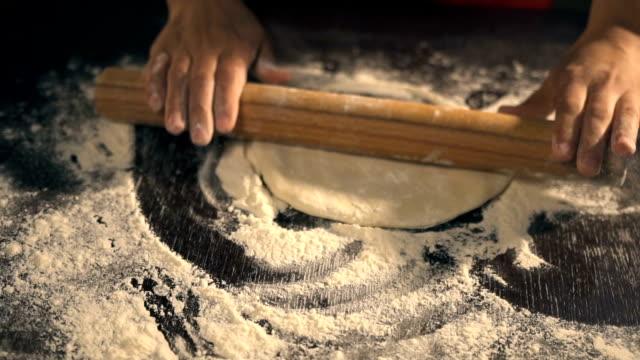 Chef preparing pizza dough. Slow Motion video