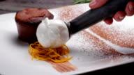 Chef put  scoops of ice cream. video
