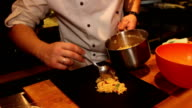 chef puts couscous with sun-dried tomatoes to board food video