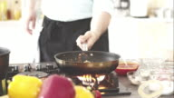 Chef puts frying pan on gas stove video