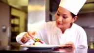 Chef putting mint leaf onto meringue video