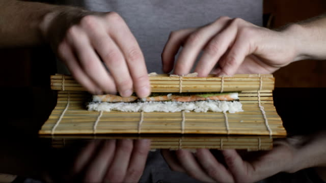 Chef rolling up sushi video