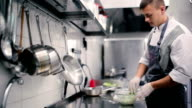 Chef salad mixes hand. video
