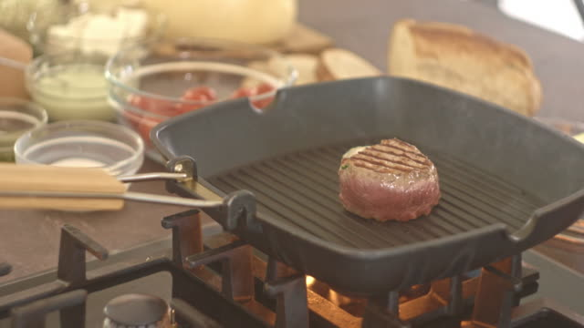 Chef salting beef steak while grilling video