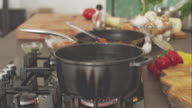 Chef salting boiling water, adding pasta video