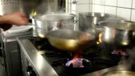 Chef sauteeing peppers over on open flame video