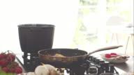 Chef seasoning spaghetti, shaking and mixing. video