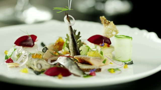Chef serving Delicious Smoked Fish Selection in Luxury Restaurant. Close-up video