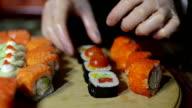 Chef serving Sushi Assortments video
