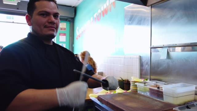 Chef Sharpening Knives in Restaurant Kitchen video