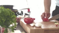 Chef slicing and chopping tomatoes on cutting board video