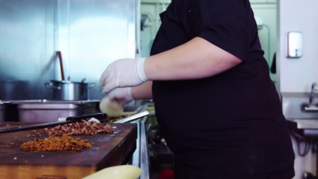 Chef Slicing Grilled Meat in Mexican Restaurant Kitchen video