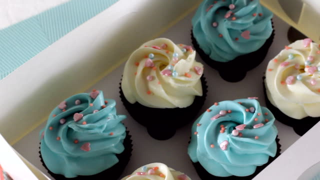 Chef take away dessert plate with cupcake. Tasty cup cake on cake plate. Tasty muffin on turquoise dish. Sweet muffin with muffin cream. Cupcake plate. Homemade cup cake. Unhealthy eating. HD video