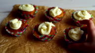 Chef take away one cupcake. Six cupcakes on cooking paper video