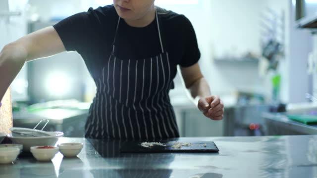Chef woman is finishing sweet dessert video