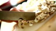 Cheff copping mushrooms. video