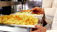 Chefs at serving trays of pasta video