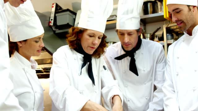 Chefs kneading dough video