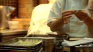 Chefs preparing food in kitchen video