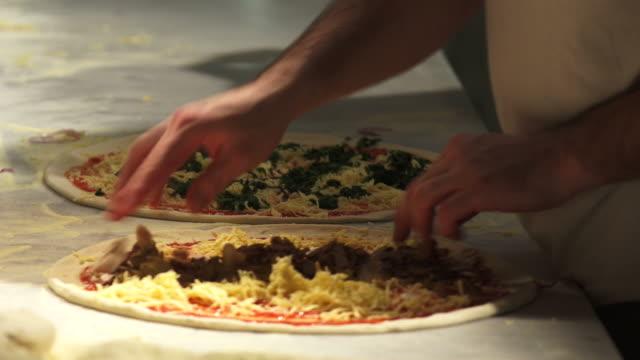 Chefs Preparing Pizzas video