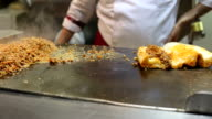 Chefs preparing Turkish Kokorec for service. Lamb intestine food sandwich video