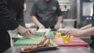 Chefs Working Together In Restaurant Kitchen video