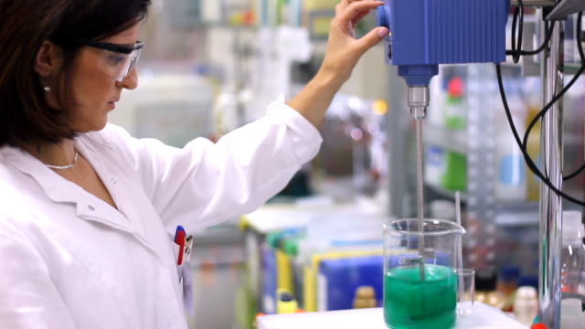 Chemical Engineer in Lab - Montage video