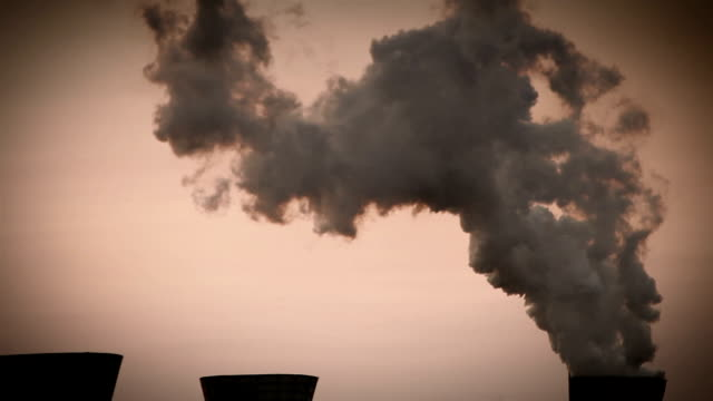 Chemical industry footage: a factory casting away used vapours into atmosphere video
