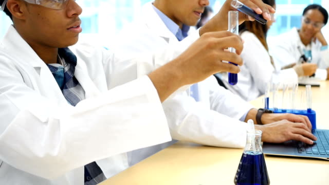 Chemist or college chemistry student analyze chemical reaction video