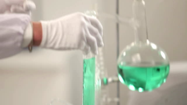 chemist or scientist working with chemical video