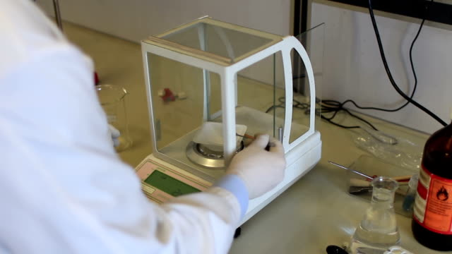 chemist weighing chemical compound video