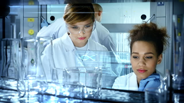 Chemists in modern Laboratory. video