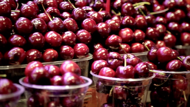 Cherries in cups at the market video