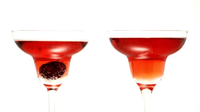 Cherry dropped into glass of red sparkling wine video