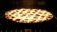 cherry pie cooking in oven video