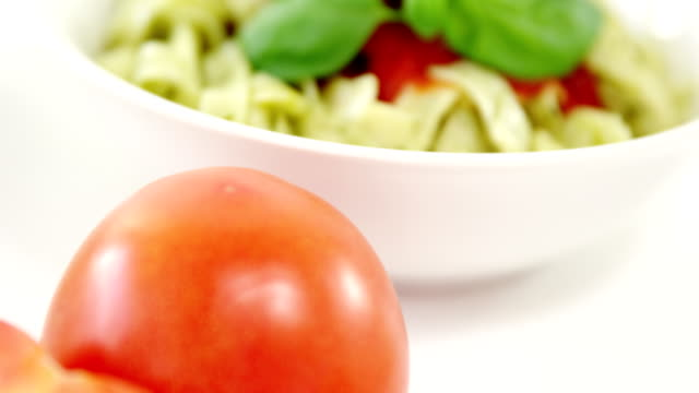 Cherry tomato with bowl of pasta video