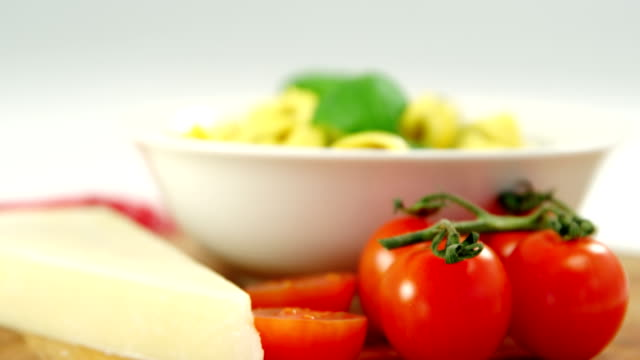 Cherry tomatoes and with bowl of pasta video