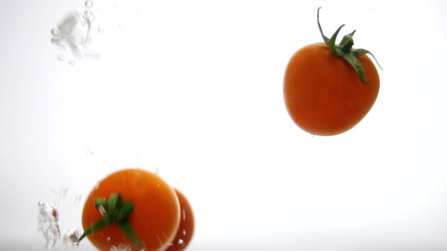 Cherry Tomatoes Splashing into the Water video