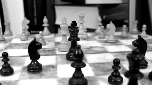 Chess board and books dolly shot video