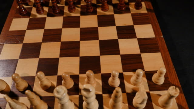 A chess board with its pieces on it video