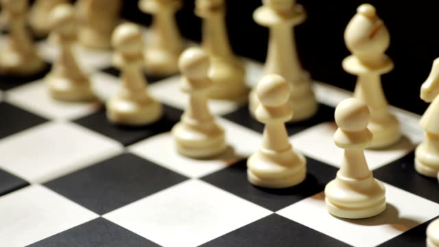 Chess board with pawn moving video