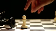 Chess hite pawn and black king video