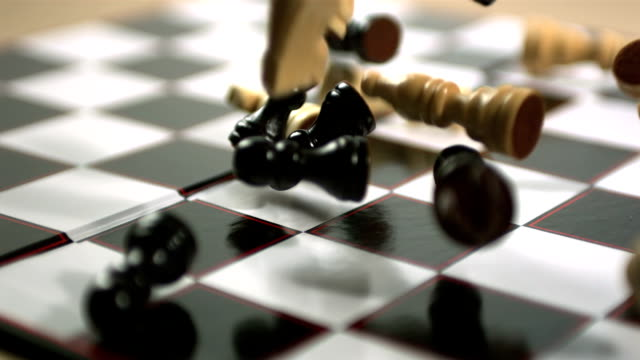 Chess pieces crashing onto board video