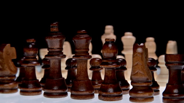 Chess pieces on white background, close-up video
