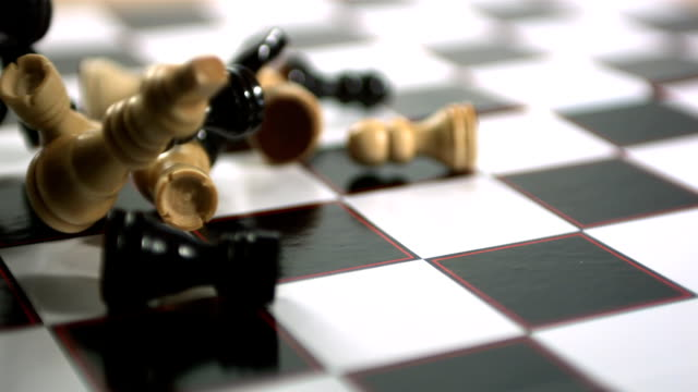Chess pieces thrown across the board video