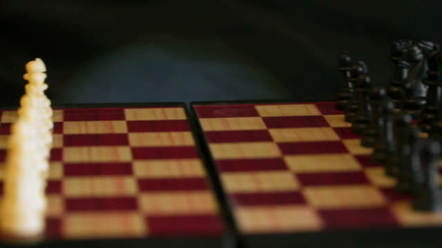 Chessboard with white and black chess. Shallow depth of field video