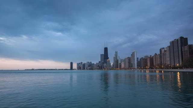 Chicago sunrise panorama with clouds and waves on Lake Michigan video