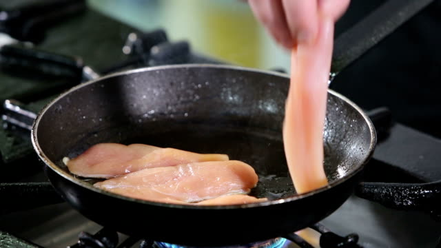 Chicken breast in cooking pan video